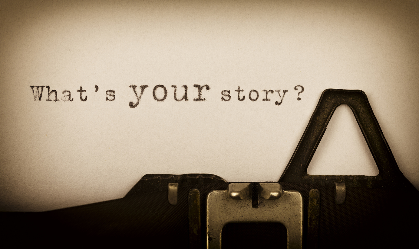 Typewriter closeup of paper saying What's your story?