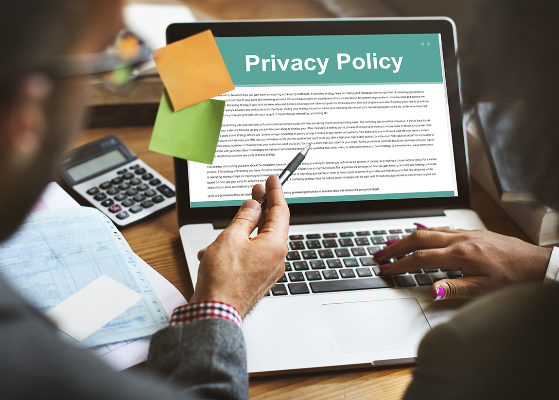 Laptop displaying a privacy policy